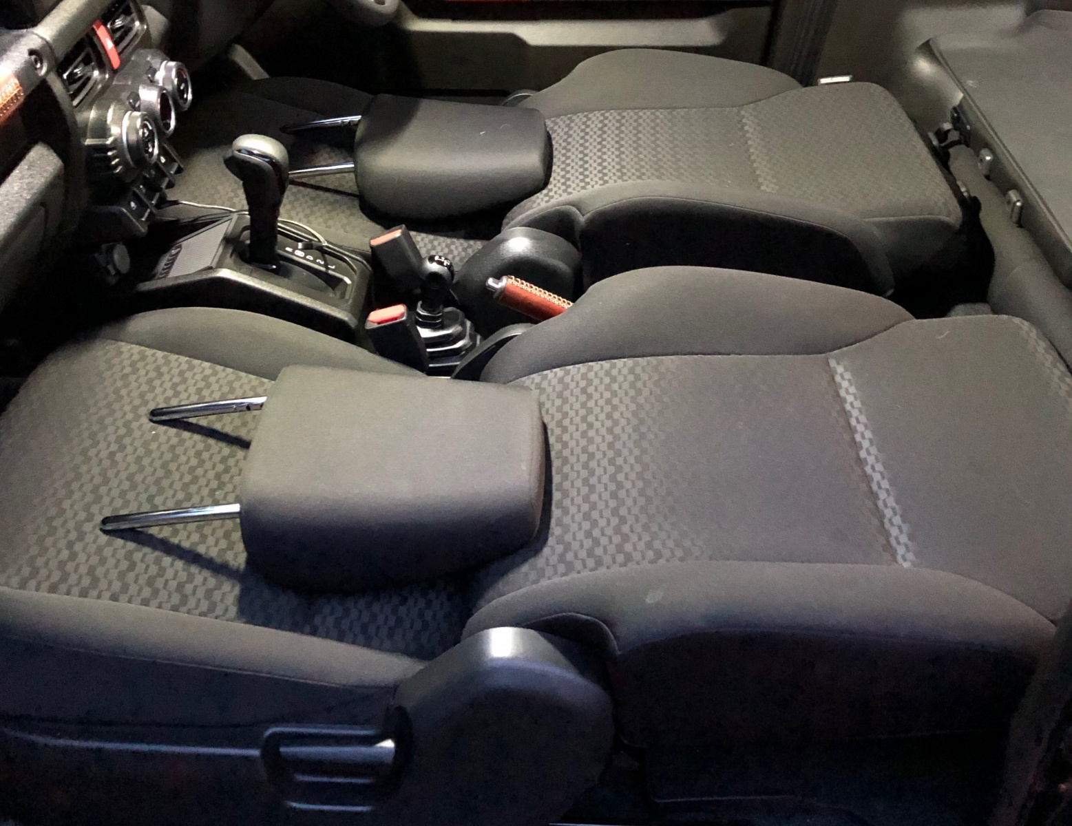 Optional placement of front headrests